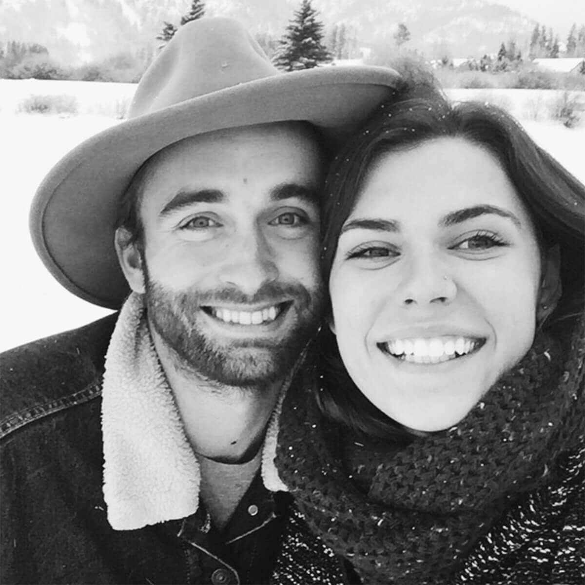 Couple posing for selfie on a snowy day