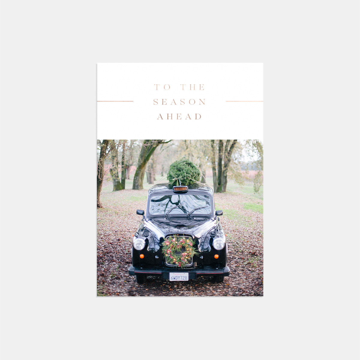 Same photo of classic car on holiday card with to the season ahead text overlay