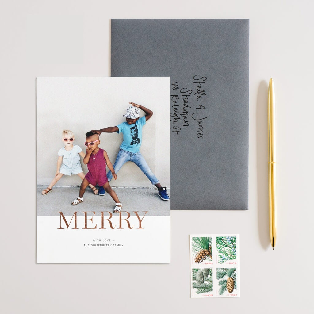 children dancing on front of holiday card
