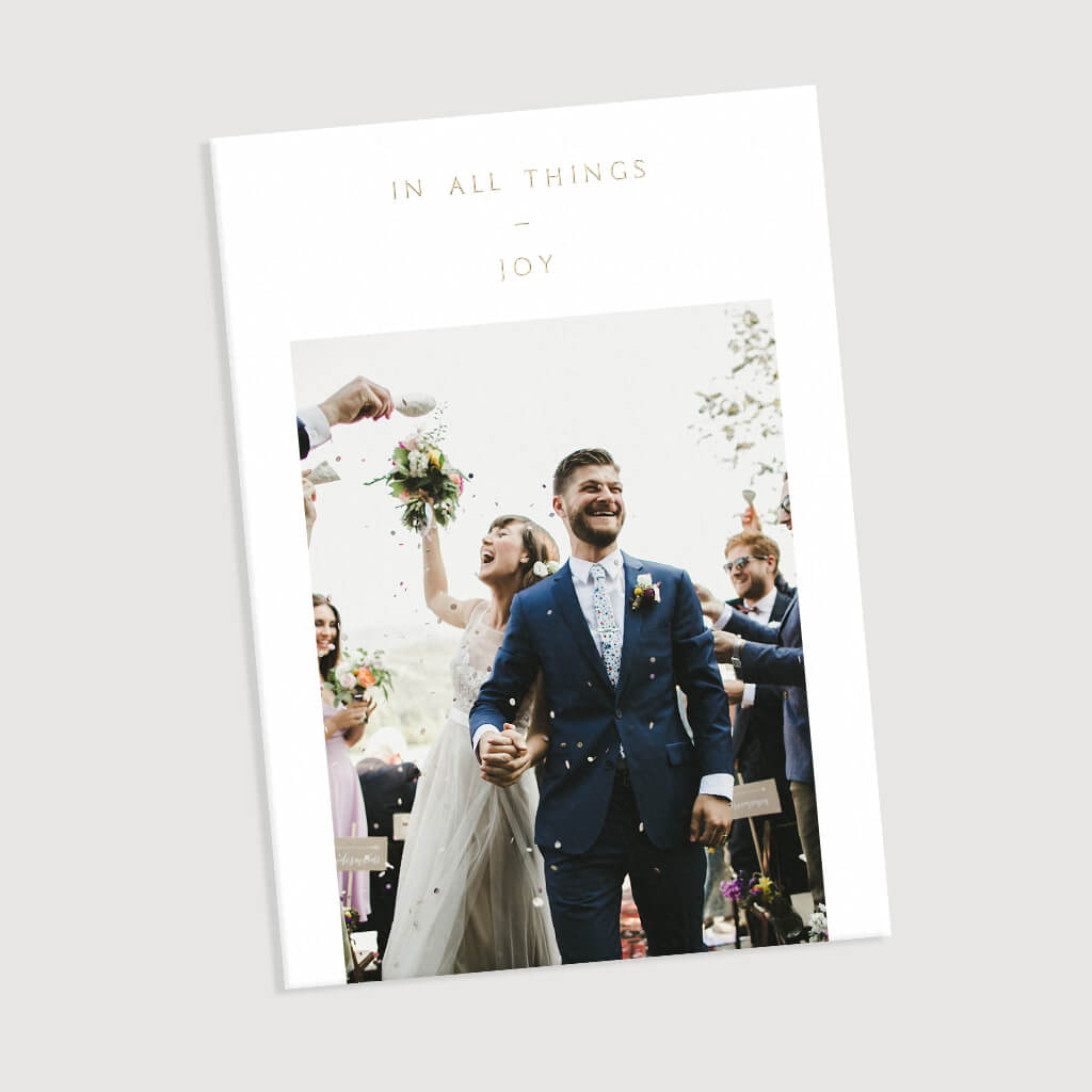Photo of couple walking down the aisle on the front of All Things Joy holiday card