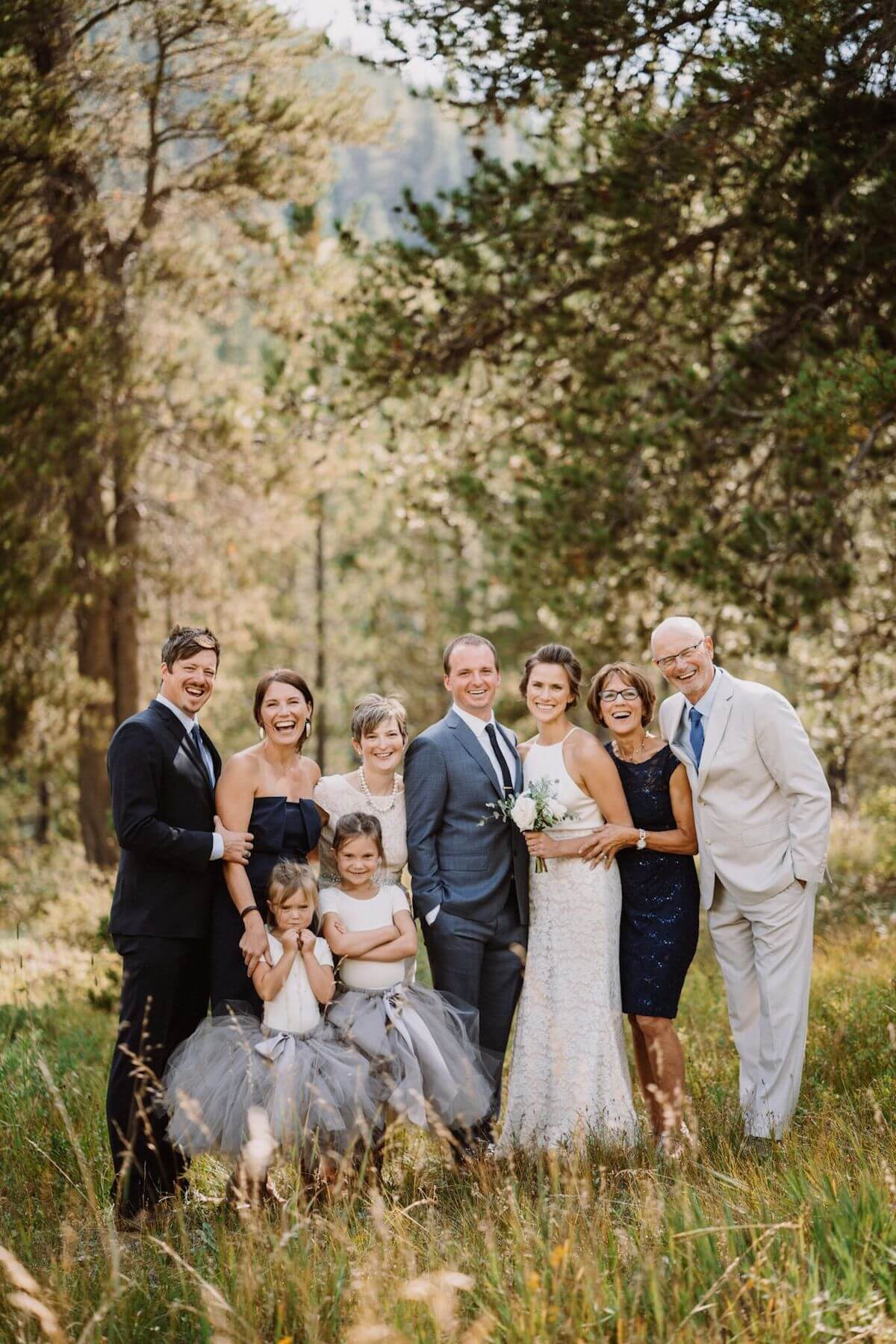 Professional family photo with bride and groom