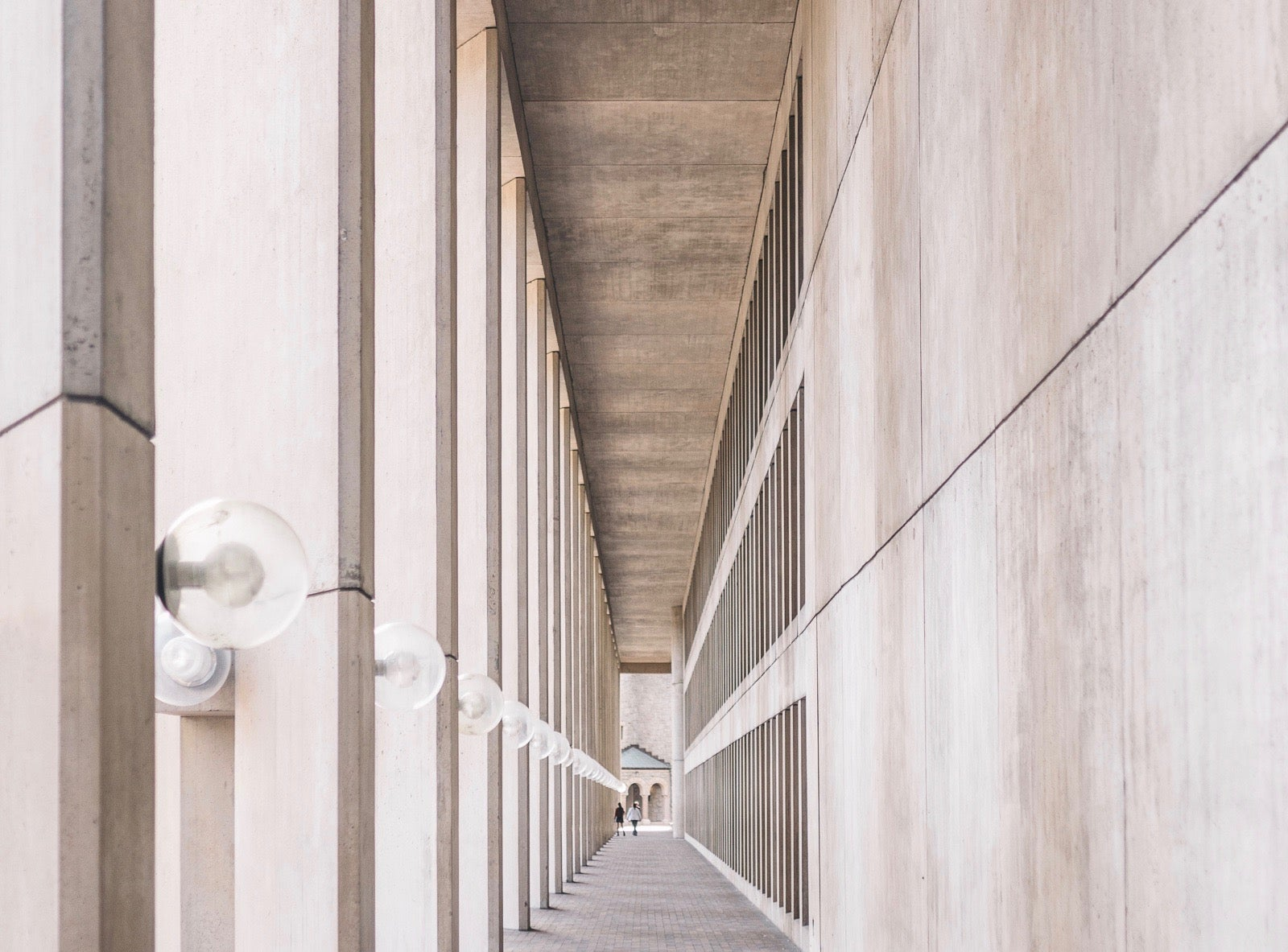 Photo down a row of columns creating an optical illusion