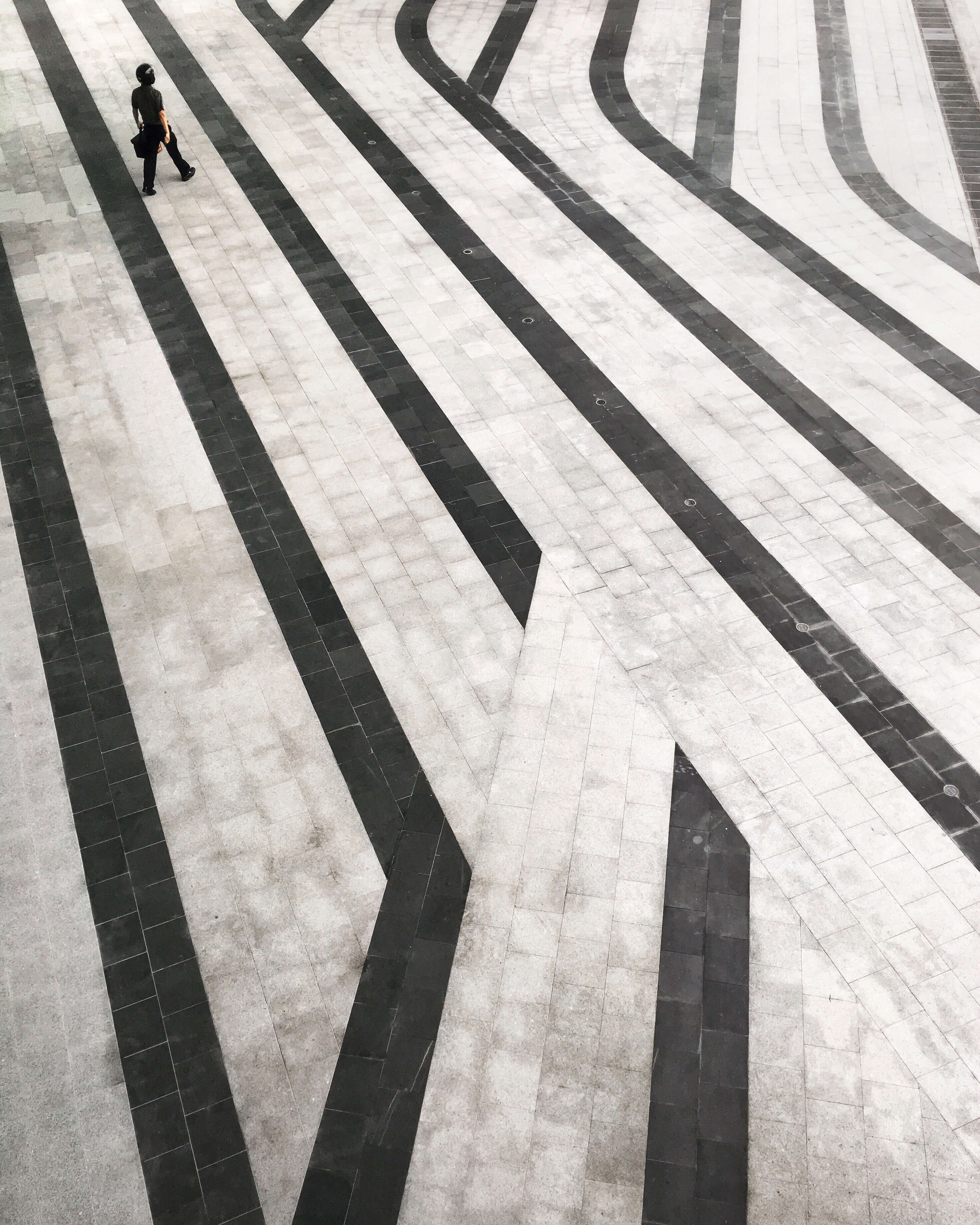 person walking across tiled floor