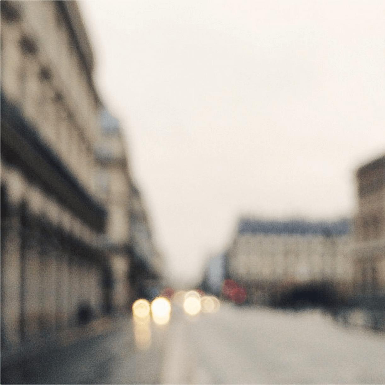 blurred photo of street and car headlights