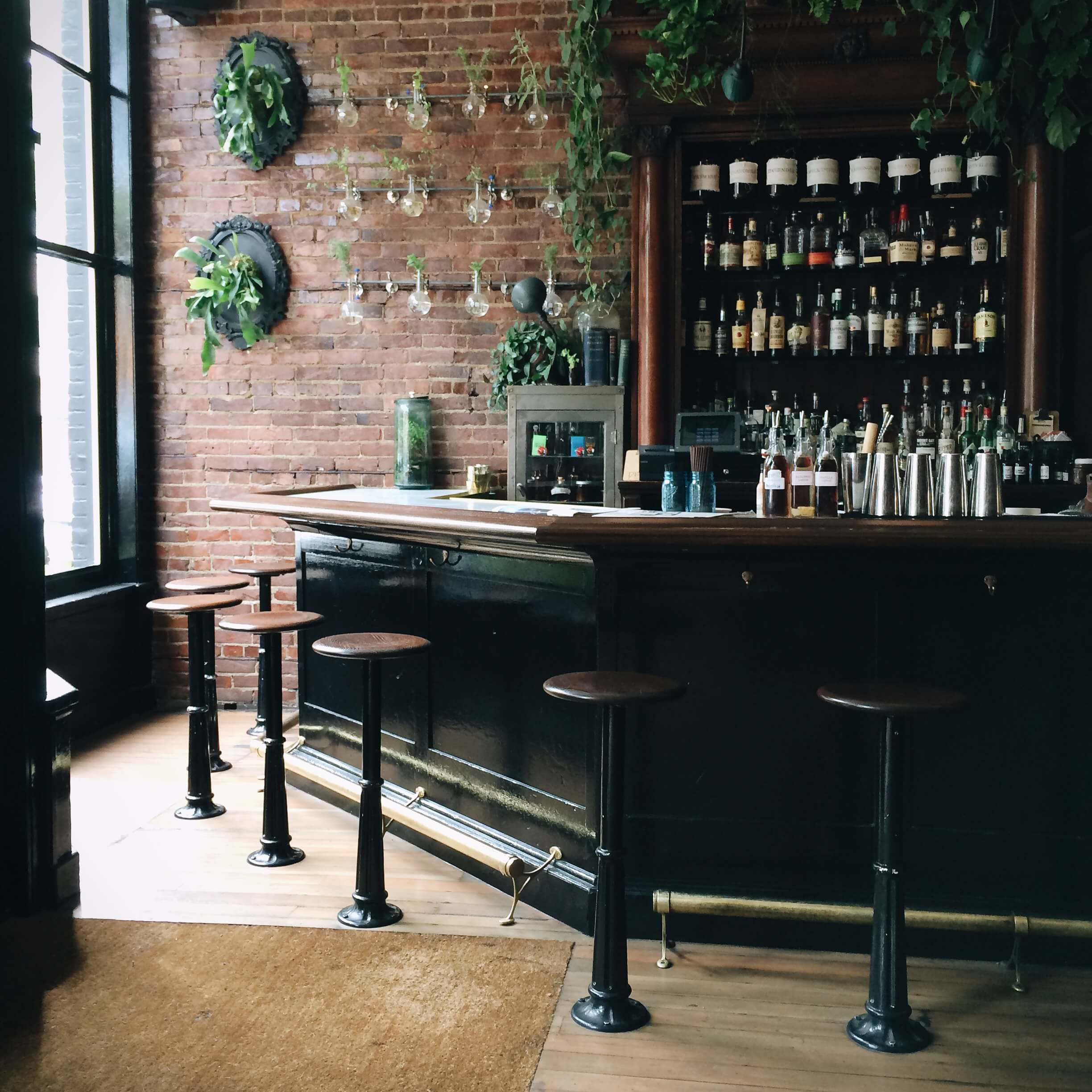 Photo of upscale bar top with light coming in through the window