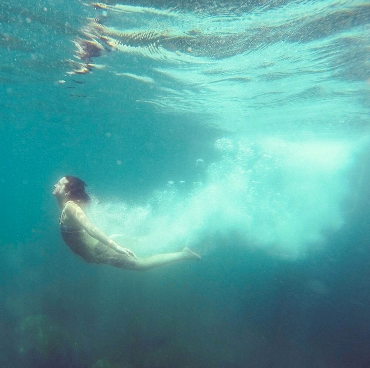 underwater photo of woman swimming