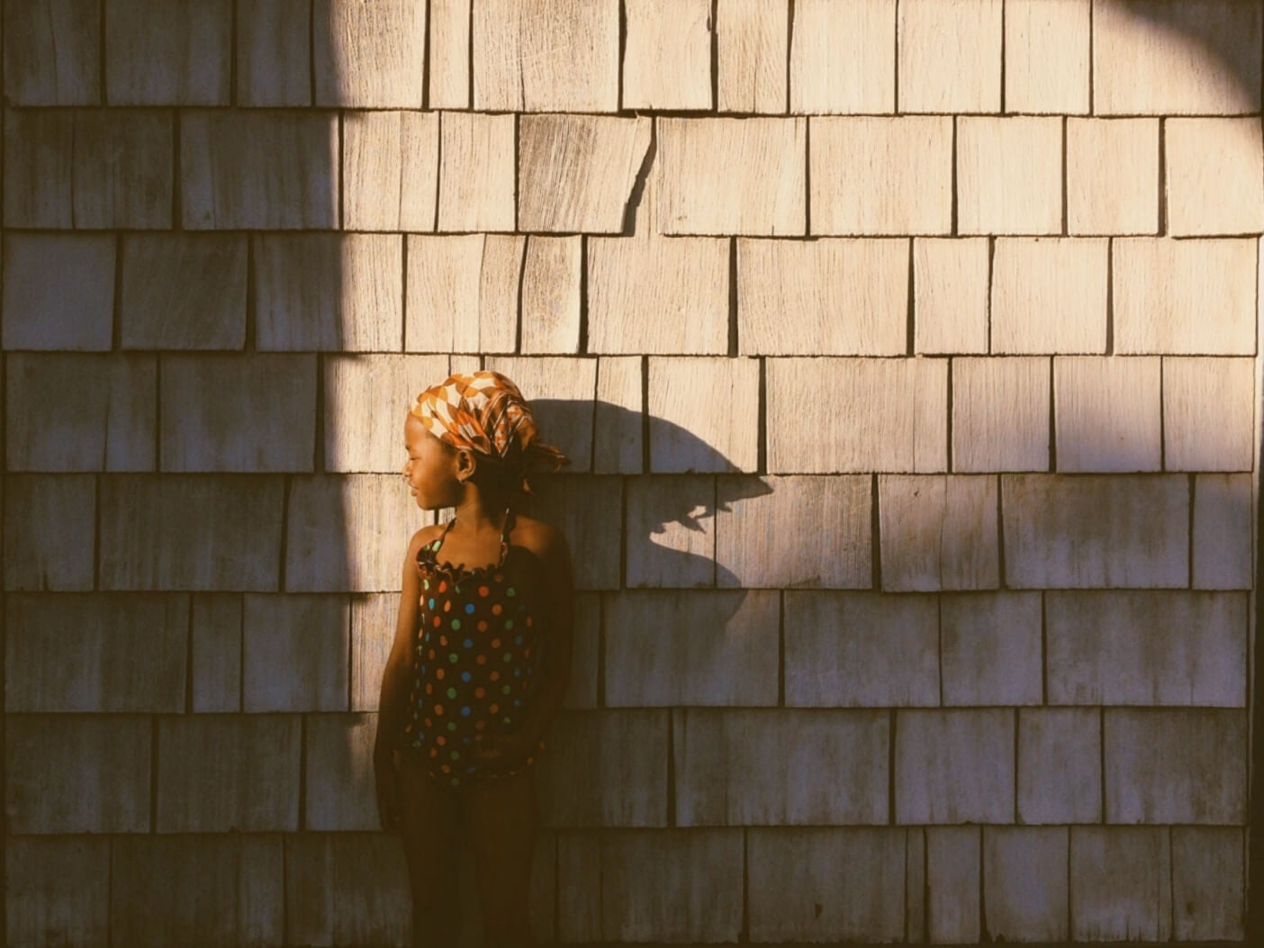 photo of child against textured wall