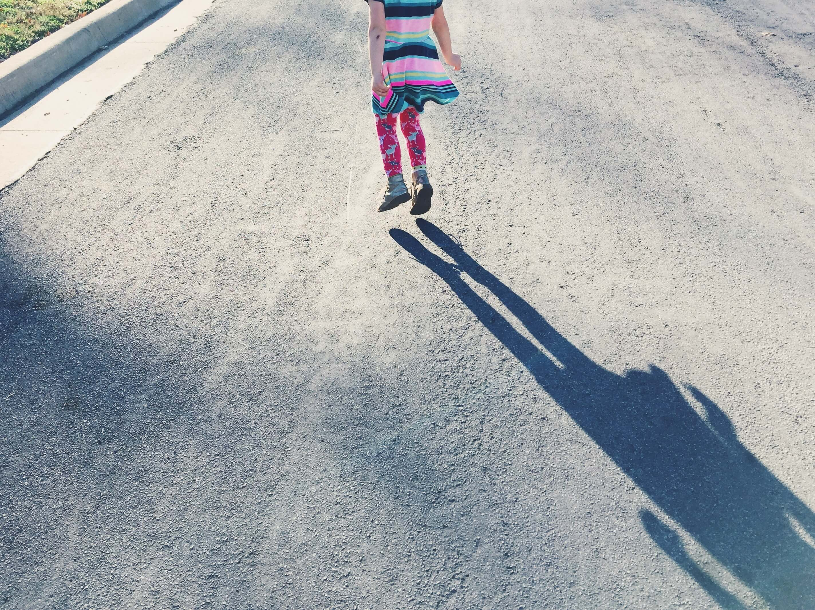 shadow of little girl jumping