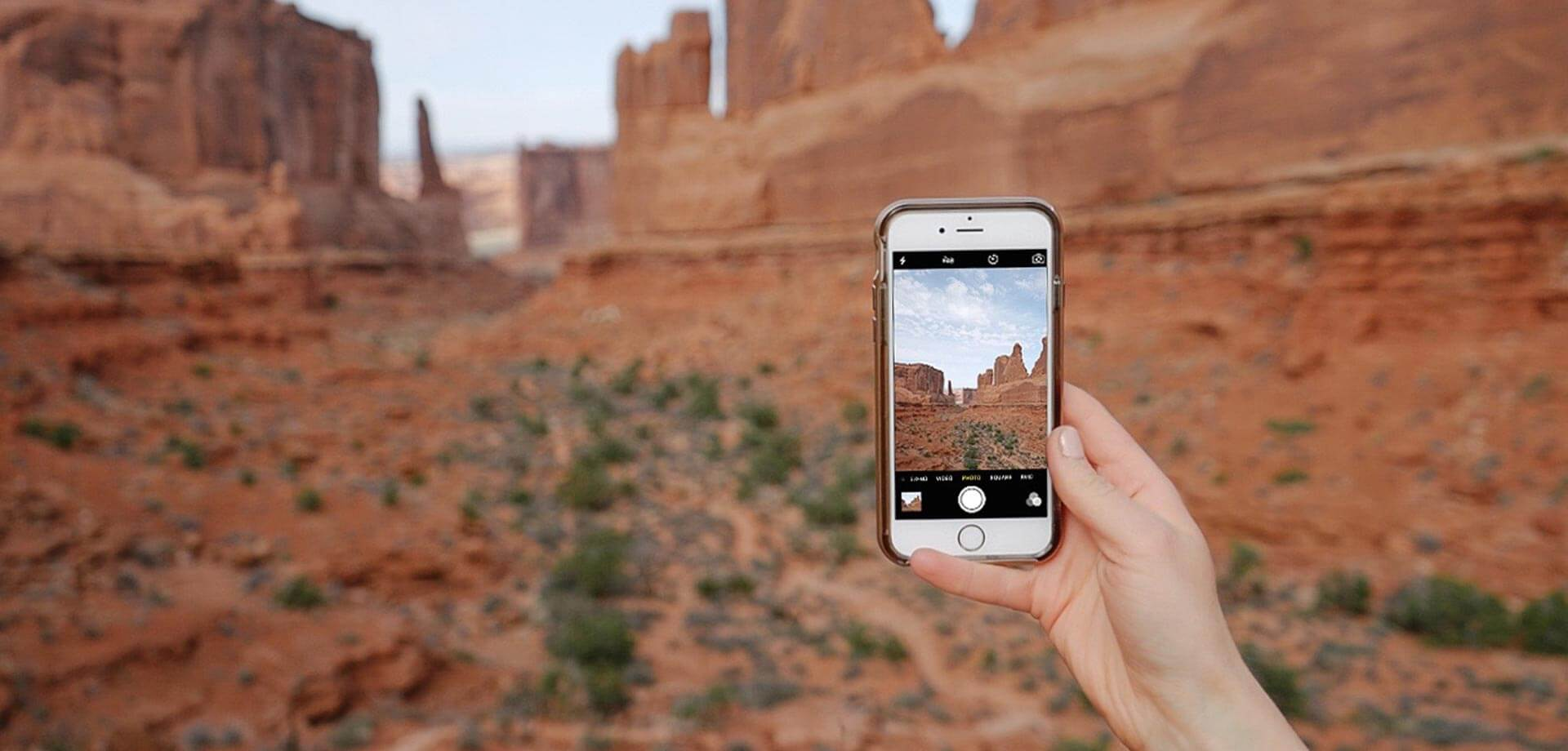 photo of phone using mobile photography tips to take a photo of red rock formations
