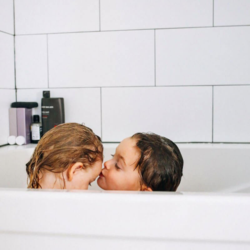 Photo of toddlers taking a bath from Days at Home album