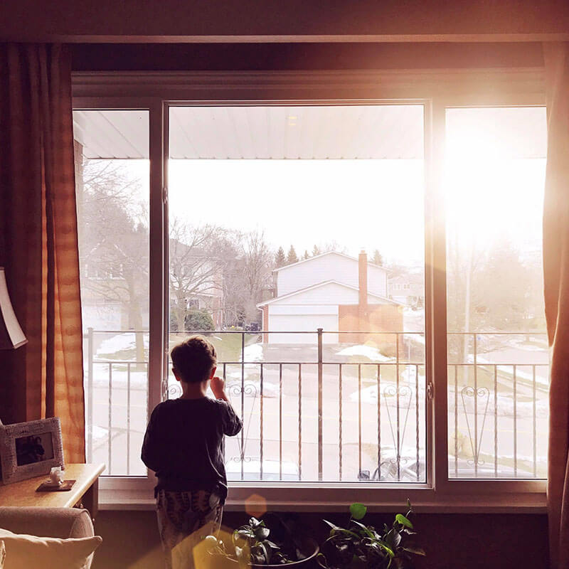 Photo of little boy in front of window from Days at Home album