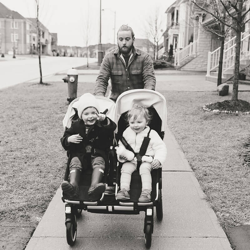 Photo of father pushing double stroller from Father's Day album