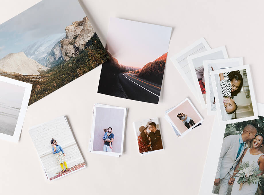 different types of photo prints strewn on table